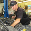 Staff photo by Cathy Spaulding<br /> Matt Young checks and changes oil in a customer's vehicle. Young operates a full-service gas station in Muskogee.