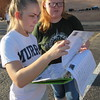 "Staff photo by Cathy Spaulding<br /> Fort Gibson High School seniors Reanna Nichols, left, and Shea Davis study the diagram for the Royal Regiment's 2016 field marching program, ""Nemesis."" Band members practice the patterns early each morning."