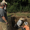 Staff photo by Harrison Grimwood<br /> Forensic anthropologists with the Office of the Chief MedicalExaminerin Oklahoma gently scrape dirt away from an unmarked grave Tuesday, hoping to uncover the remains without damaging them.