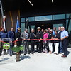 KENTON BROOKS/Muskogee Phoenix<br /> Principal Chief James R. Floyd of the Muscogee (Creek) Nation, center, gets ready to cut the ribbon in front of the Eufaula Indian Health Center on Tuesday. The 79,000-square-foot facility replaces the old center, which was 6,000 square feet.