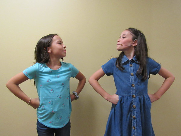 """CATHY SPAULDING/Muskogee Phoenix<br /> Mazzy Waters, left, and Ella Strickland strike the same defiant tone as the precocious 5-year-old Matilda. The girls alternate playing the part in the Muskogee Little Theatre production """"Matilda the Musical."""""""