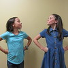 "CATHY SPAULDING/Muskogee Phoenix<br /> Mazzy Waters, left, and Ella Strickland strike the same defiant tone as the precocious 5-year-old Matilda. The girls alternate playing the part in the Muskogee Little Theatre production ""Matilda the Musical."""