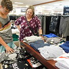 CATHY SPAULDING/Muskogee Phoenix<br /> Denver Morgan, 13, of Warner, inspects shirts with his grandmother, Debbie Teague at JCPenney. Teague said the family plans to take advantage of Tax Free Weekend this week.