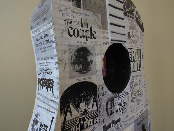 A fiberglass guitar sculpture at Muskogee Little Theatre features programs from past shows. Artist Nancy Wilkinson applied programs she had in her collection.