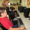 Staff photo by Cathy Spaulding<br /> St. Joseph Catholic School Principal Joanne Myers reviews a computerized test with fifth-grader Nicholas Herrera, left, while fifth-grader Michael Tebedo works at his computer. Thursday marked St. Joseph Catholic School's first day of school with a new principal, Joanne Myers, a former school counselor. Myers said the year began with 105 students, but more are expected.