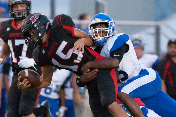 Phoenix special photo by Von Castor<br /> Checotah's Ronny Hall pulls down Hilldale's Trae Davison in last season's matchup. In addition to being a<br /> defender, Hall emerged as a prime ground game performer on offense.