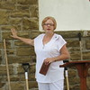 Staff photo by Cathy Spaulding<br /> Ann Rossi shows how buying an Honor Brick could help pay for new mortar at 114-year-old Warner United Methodist Church. Rossi is chairwoman of the church board of trustees.
