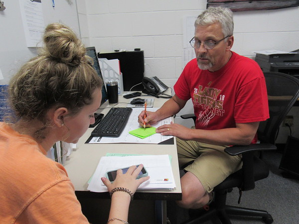 CATHY SPAULDING/Muskogee Phoenix<br /> Fort Gibson High School sophomore Britney Taylor works with counselor Bruce French on changing her class schedule. Fort Gibson High School students are adjusting schedules before the start of school. The first day of classes at Fort Gibson Schools is Aug. 17.