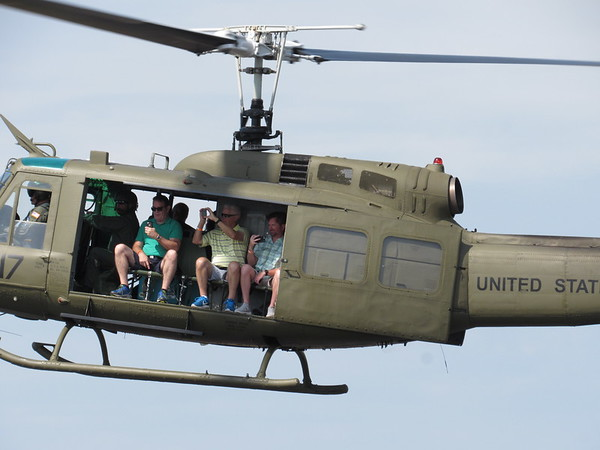 CATHY SPAULDING/Muskogee Phoenix<br /> A Huey helicopter carrying passengers, from left, Frank Godman, Jerry Cook and Andy Cook lands at Muskogee-Davis Regional Airport as part of the CAF Air Power History Tour.