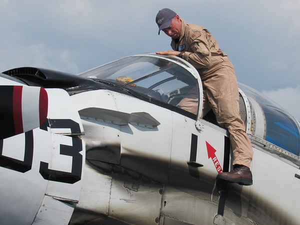 CATHY SPAULDING/Muskogee Phoenix<br /> Pilot Mark Todd gets out of an AD-5 Skyraider after landing Saturday at Muskogee-Davis Regional Airport. The Skyraider was one of the featured planes of the CAF Air Power History Tour.