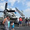 CATHY SPAULDING/Muskogee Phoenix<br /> Visitors look at an AD-5 Skyraider after its Saturday morning arrival at Muskogee-Davis Regional Airport. It was one of the featured planes at the CAF Air Power History Tour.