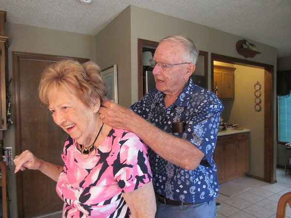 Keith Walters helps his wife, Jean, with her necklace. He said they have been married for 66 years.