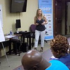 Staff photo by Mike Elswick<br /> Treasure McKenzie, director of Muskogee's Bridges Out of Poverty program, leads a class of community members interested in learning more about the program.