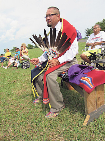 """CATHY SPAULDING/Muskogee Phoenix<br /> Phillip """"Bugsy"""" Barnoskie shakes a rattle as he prepares to join the Gourd Dance at the Warriors for a Cure Powwow. Dancers, singers and drummers from across the area joined in the Warriors for a Cure Powwow, held Saturday at Three Rivers Health Center. The powwow was held to raise awareness of cancer and raise funds for the American Cancer Society."""