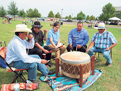 Drummers — from left, John McIntosh, Jamison Concha, Minese, Kenneth Foreman and Chris Hill — beat a drum to start the Gourd Dance at the Warriors for a Cure Powwow. Concha was the powwow's lead singer.