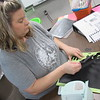 CATHY SPAULDING/Muskogee Phoenix<br /> Mallie Bemo pulls apart lettering stencils as she helps her mother, Shawn Dickmann, set up her third-grade classroom at Intermediate Elementary School.