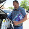 CATHY SPAULDING/Muskogee Phoenix <br /> Garry Hayes, general manager of American Foundry Group, unloads school supplies from a vehicle Monday afternoon. American Foundry employees collected more than $500 in school supplies for Irving Elementary School. Foundry general manager Garry Hayes said a number of employees have children at Irving. He said they surveyed Irving faculty about their greatest classroom needs. He said employees collected chlorine wipes, tissue, pencils, erasers and other items beyond basic supplies provided by Muskogee Public Schools. Classes begin Thursday at MPS.
