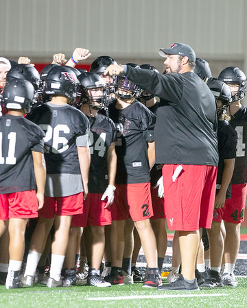 VON CASTOR/Special to the Phoenix<br /> Hilldale head coach David Blevins leads the Hornets in a midnight practice Monday morning. Hilldale opens the season at 7 p.m. Sept. 6 at Sequoyah. Gore, Haskell and Warner are among schools that begin their seasons on Aug. 30.