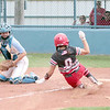 JOHN HASLER/Phoenix Special Photo<br /> Fort Gibson's Erica Hornback scores on an errant throw to Oktaha catcher Karli Ashing during Tuesday's action.