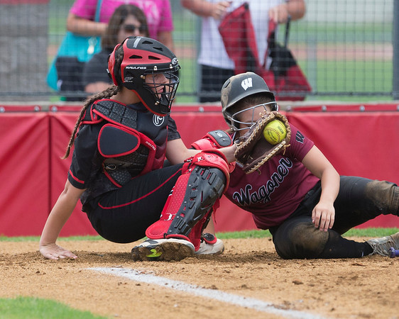 Phoenix special photo by Von Castor<br /> Hilldale's Kenna Hoffman takes the throw from first baseman Abby Isham to complete a double-play in the first by tagging out Wagoner's Payton Stroud. Hilldale won 10-3.