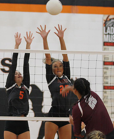 Phoenix special photo by Abigail Washington<br /> Sequoyah's Jonia Walker, spikes over the net against the defense of Okay's Macey Anderson and Kristen Anderson in Tuesday's match at Okay.