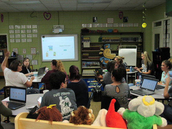 Staff photo by Cathy Spaulding<br /> Muskogee Public Schools teachers gather at Cherokee Elementary library to learn about the Class Dojo app. The presentation was part of a professional development day before school starts Thursday.