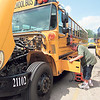 CATHY SPAULDING/Muskogee Phoenix<br /> ABOVE: Muskogee Public Schools Transportation Department mechanic Billy Turner charges a school bus battery Wednesday afternoon. Transportation officials spent Wednesday getting buses ready for the kickoff of the new school year, which begins today.