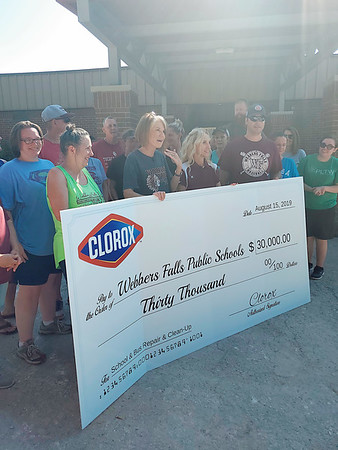 CHESLEY OXENDINE/Muskogee Phoenix<br /> Staff and administration of Webbers Falls Public Schools laugh, cheer and hold back tears at the receipt of a $30,000 donation from Clorox.