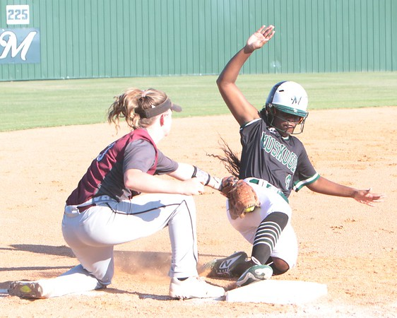 JOHN HASLER/Phoenix Special Photo<br /> Muskogee's Isyss Patton beats the tag of Sequoyah's Kyilee Chumley for a two-run triple in Thursday's game at Roughers Park. It gave MHS an early lead in what became a 22-2 loss.