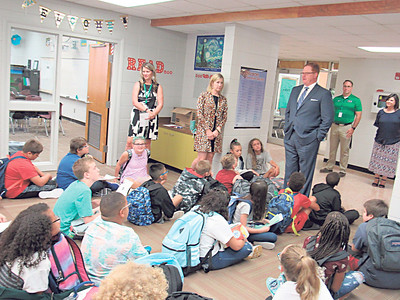 Muskogee Public Schools Superintendent Dr. Jarod Mendenhall, in coat and tie, speaks to students at the Sixth Grade Academy on the first day of school.