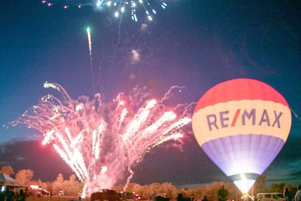 SHANE KEETER/Special to the Phoenix<br /> Fireworks and a hot air balloon light up Hatbox Field on the first day of the Oklahoma Festival of Ballooning. The event concludes Saturday.