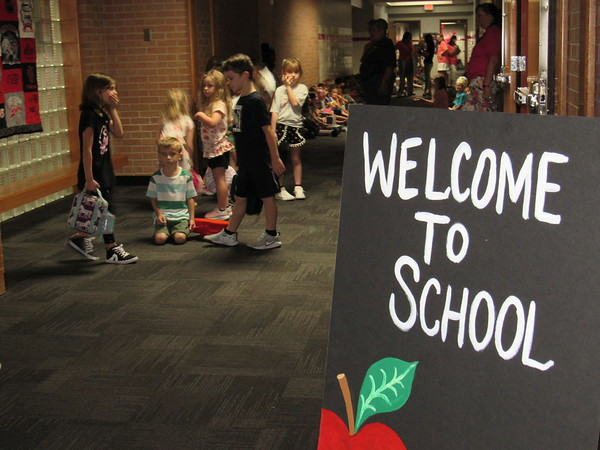 CATHY SPAULDING/Muskogee Phoenix<br /> Early Learning Center pupils wait in the hallway to go to their first lunch of the school year. Thursday marked the first day of classes at Fort Gibson Public Schools. Over summer, the district built a turn-around driveway in front of the administration building to ease traffic on campus, especially when high school and middle school students were on campus. Superintendent Scott Farmer said the driveway has helped with traffic. The Early Learning Center reported about 490 children on its first day.
