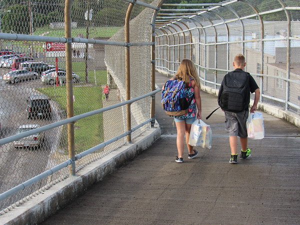 Staff photo by Cathy Spaulding<br /> Two youngsters cross the Peak Boulevard pedestrian overpass on their way to Hilldale Elementary Schools. Thursday was Hilldale's first day of classes.
