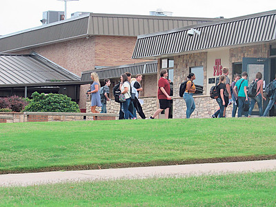 Fort Gibson students enter Fort Gibson High School on the first day of class Friday.