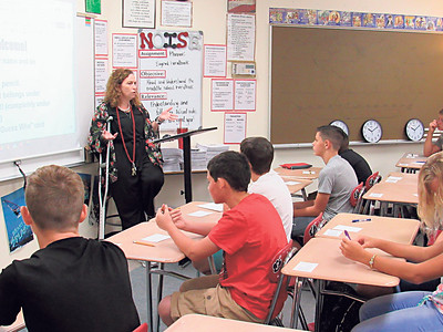 CATHY SPAULDING/Muskogee Phoenix Katrina White, sixth-grade geography teacher, gives rules to her class Friday on the first day of school at Fort Gibson Middle School.