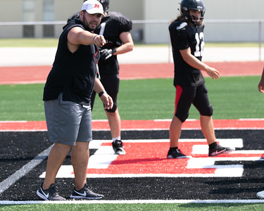 SHANE KEETER/Special to the Phoenix Hilldale offensive coordinator Erwin Starts directs practice on Friday.