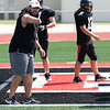 SHANE KEETER/Special to the Phoenix<br /> Hilldale offensive coordinator Erwin Starts directs practice on Friday.