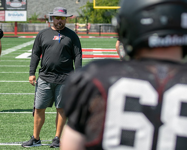 SHANE KEETER/Special to the Phoenix Hilldale co-defensive coordinator Kaleb Harris directs practice on Friday.