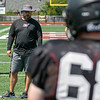 SHANE KEETER/Special to the Phoenix<br /> Hilldale co-defensive coordinator Kaleb Harris directs practice on Friday.