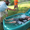 CATHY SPAULDING/Muskogee Phoenix<br /> Jeff McCoy, left, films Jim Landis in a kiddie pool for a Boulevard Christian Church promotional video.