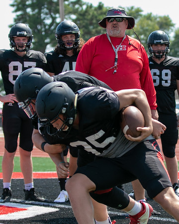 SHANE KEETER/Special to the Phoenix<br /> Hilldale co-defensive coordinators Ernie Ragland watches a tackling drill during Friday's practice.