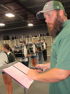 CATHY SPAULDING/Muskogee Phoenix Jeff McCoy checks timing and beat of the Muskogee High School drum line during a band practice.