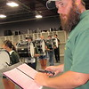 CATHY SPAULDING/Muskogee Phoenix<br /> Jeff McCoy checks timing and beat of the Muskogee High School drum line during a band practice.