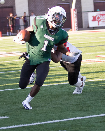 Phoenix special photo by Shane Keeter<br /> Muskogee's D.J. Mayers gets around a Jenks defender for a big gain during the Roughers' scrimmage on Friday at Jenks.