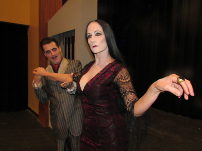"CATHY SPAULDING/Muskogee Phoenix Gomez Addams (Seth Arnold) woos his wife Morticia (Andrea Wilxoxen) in the upcoming Muskogee Little Theatre production ""The Addams Family."""