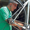 Staff photo by Cathy Spaulding<br /> Ronald Milligan works on one of many bikes he keeps in his garage. He began working on bikes shortly after getting his first one as a child.