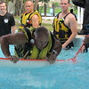 CATHY SPAULDING/Muskogee Phoenix<br /> Muskogee firefighter Fred Fielder gets over a water barrier while doing water rescue training Monday at River Country Water Park. Muskogee Fire Department is training firefighters in water rescue techniques this week. Assistant Fire Chief John Tipton said firefighters are learning new techniques on how to maneuver obstacles such as logs in the water. He said they also are learning safe ways to walk as a group against the current. Tipton recalled a storm in 2017 when firefighters made 22 rescues in an hour and a half during heavy rains. Jeff Watkins, fire department training officer, said the department is conducting training sessions over six days, with different groups training each day.