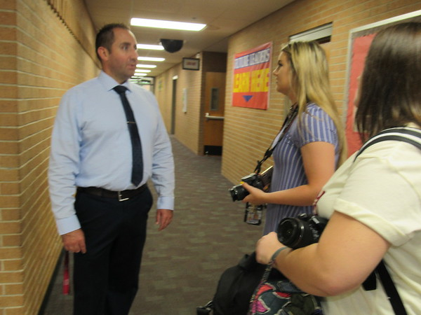 CATHY SPAULDING/Muskogee Phoenix<br /> Fort Gibson Middle School Principal Ben Pemberton meets with members of the high school yearbook staff, Simone Daniels, center and Baylee Hare, on the first day of school.