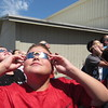 Staff photo by Cathy Spaulding<br /> Hilldale Middle School student Jace Johnson gets his own perspective on Monday afternoon's solar eclipse while looking through special visors.
