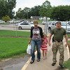 Staff photo by Cathy Spaulding<br /> Candace and William Peters escort their 5-year-old daughter Teagan up the sidewalk to Early Learning Center for her first day of school.